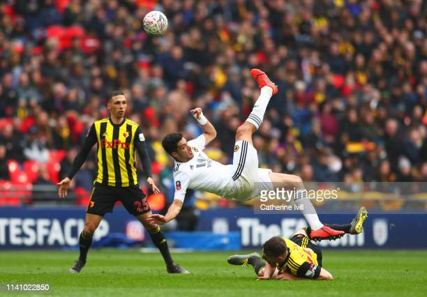 Raul Jimenez of Wolverhampton Wanderers battles with Craig Cathcart and Jose Holebas of Watford during the FA Cup Semi Final match between Watford...