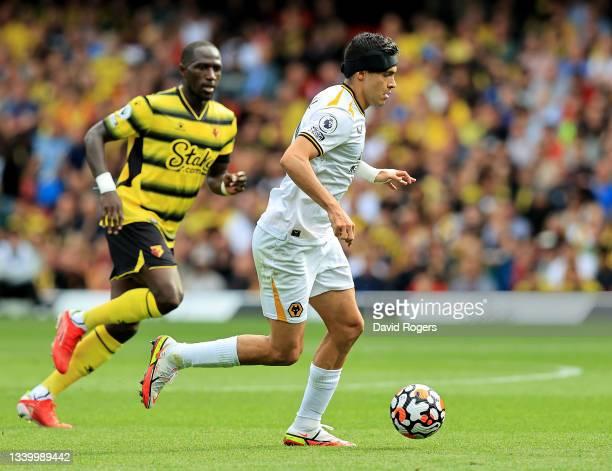 Raul Jimenez of Wolverhampton Wanderers breaks away from Moussa Sissoko during the Premier League match between Watford and Wolverhampton Wanderers...