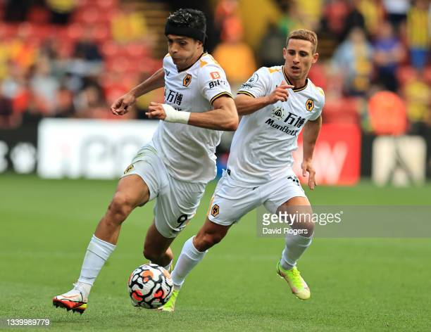 Raul Jimenez of Wolverhampton Wanderers breaks with the ball with team mate Daniel Podence in support during the Premier League match between Watford...
