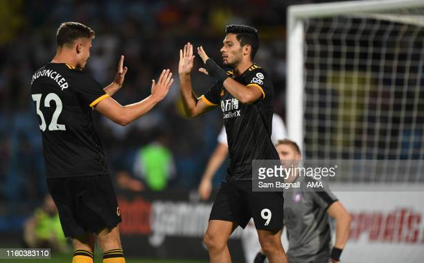 Raul Jimenez of Wolverhampton Wanderers celebrates after scoring a goal to make it 03 with Leander Dendoncker of Wolverhampton Wanderers during the...