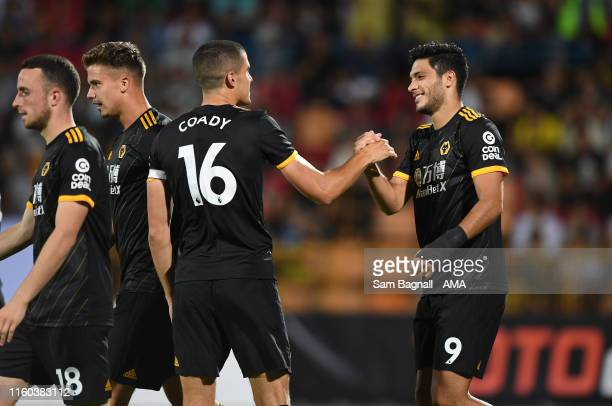 Raul Jimenez of Wolverhampton Wanderers celebrates after scoring a goal to make it 03 with Conor Coady of Wolverhampton Wanderers during the UEFA...