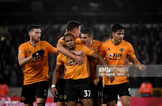 Raul Jimenez of Wolverhampton Wanderers celebrates after scoring a goal to make it 22 with Adama Traore of Wolverhampton Wanderers during the Premier...