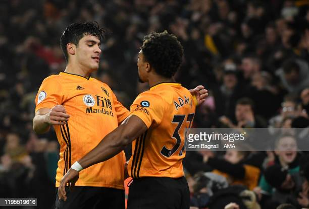 Raul Jimenez of Wolverhampton Wanderers celebrates after scoring a goal to make it 1-1 with Adama Traore during the Premier League match between...