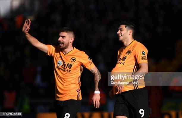Raul Jimenez of Wolverhampton Wanderers celebrates after scoring a goal to make it 30 with Ruben Neves during the Premier League match between...