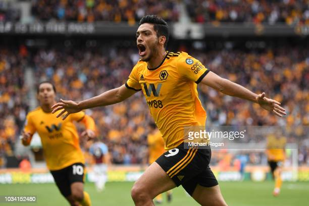 Raul Jimenez of Wolverhampton Wanderers celebrates after scoring his team's first goal during the Premier League match between Wolverhampton...