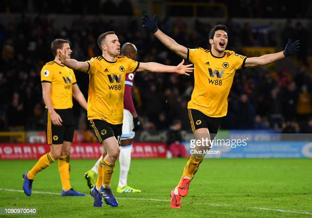 Raul Jimenez of Wolverhampton Wanderers celebrates after scoring his team's second goal with his team mates during the Premier League match between...