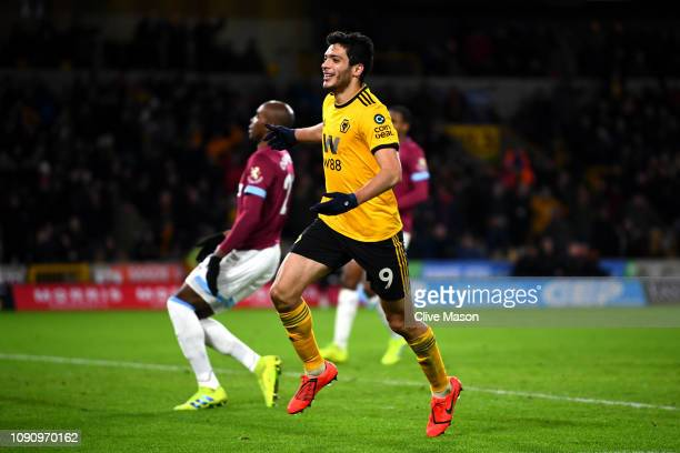 Raul Jimenez of Wolverhampton Wanderers celebrates after scoring his team's third goal as Angelo Ogbonna of West Ham United reacts during the Premier...