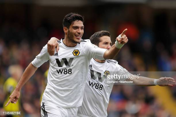 Raul Jimenez of Wolverhampton Wanderers celebrates after scoring his team's first goal with Joao Moutinho during the Premier League match between...