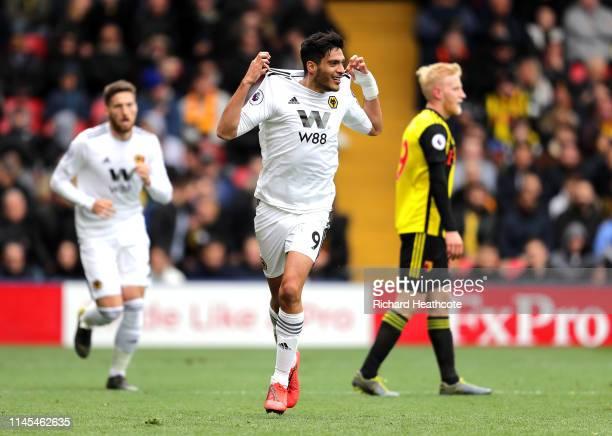 Raul Jimenez of Wolverhampton Wanderers celebrates after scoring his team's first goal during the Premier League match between Watford FC and...