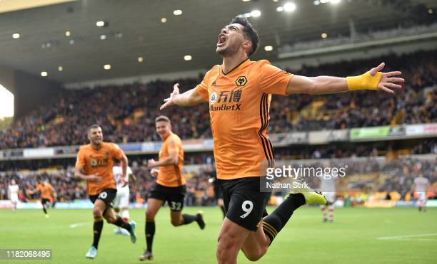 Raul Jimenez of Wolverhampton Wanderers celebrates after scoring his team's first goal before it is disallowed by VAR during the Premier League match...