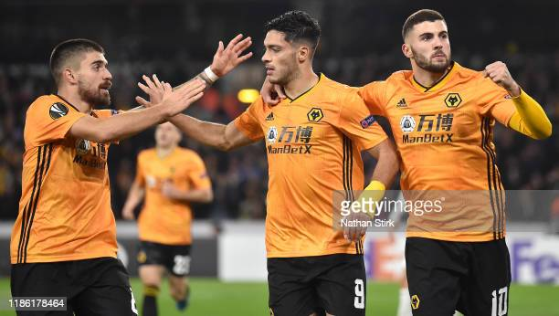 Raul Jimenez of Wolverhampton Wanderers celebrates after scoring his team's first goal with Patrick Cutrone and Ruben Neves during the UEFA Europa...