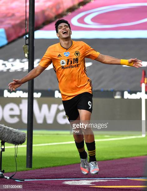 Raul Jimenez of Wolverhampton Wanderers celebrates after scoring his team's first goal during the Premier League match between West Ham United and...