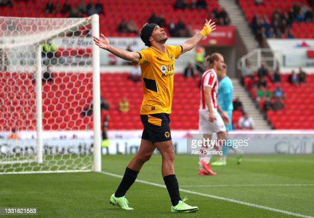 Raul Jimenez of Wolverhampton Wanderers celebrates after scoring their sides first goal during a Pre-Season Friendly match between Stoke City and...