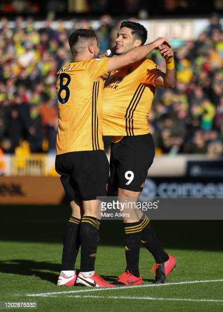 Raul Jimenez of Wolverhampton Wanderers celebrates his goal with Ruben Neves during the Premier League match between Wolverhampton Wanderers and...