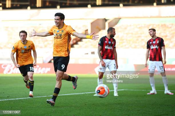 Raul Jimenez of Wolverhampton Wanderers celebrates scoring the opening goal with Diogo Jota during the Premier League match between Wolverhampton...