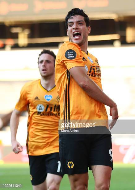 Raul Jimenez of Wolverhampton Wanderers celebrates scoring the winning goal with Diogo Jota during the Premier League match between Wolverhampton...