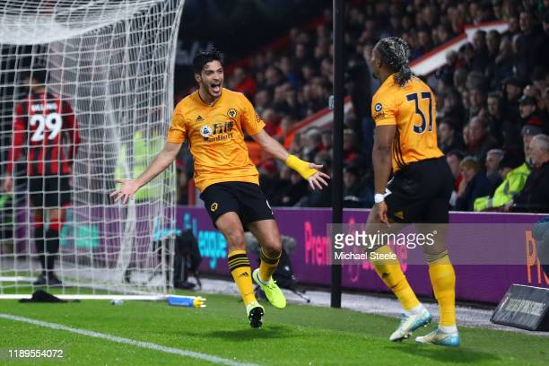 Raul Jimenez of Wolverhampton Wanderers celebrates with Adama Traore of Wolverhampton Wanderers after scoring his team's first goal during the...