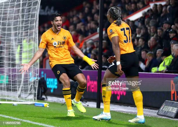 Raul Jimenez of Wolverhampton Wanderers celebrates with Adama Traore after scoring his team's first goal during the Premier League match between AFC...