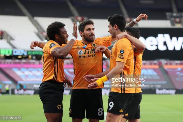 Raul Jimenez of Wolverhampton Wanderers celebrates with Adama Traore after scoring a goal to make it 0-1 during the Premier League match between West...
