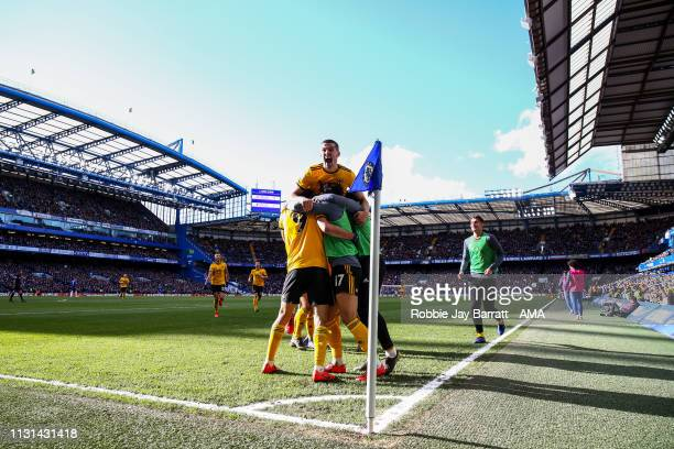Raul Jimenez of Wolverhampton Wanderers celebrates with his team mates after scoring a goal to make it 01 during the Premier League match between...