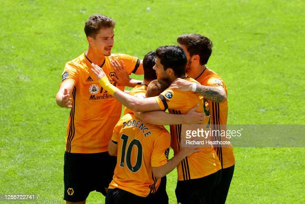Raul Jimenez of Wolverhampton Wanderers celebrates with his team after scoring his sides from goal from the penalty spot during the Premier League...
