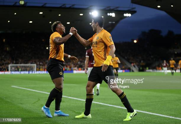 Raul Jimenez of Wolverhampton Wanderers celebrates with team mate Adama Traore after scoring his team's first goal during the UEFA Europa League...