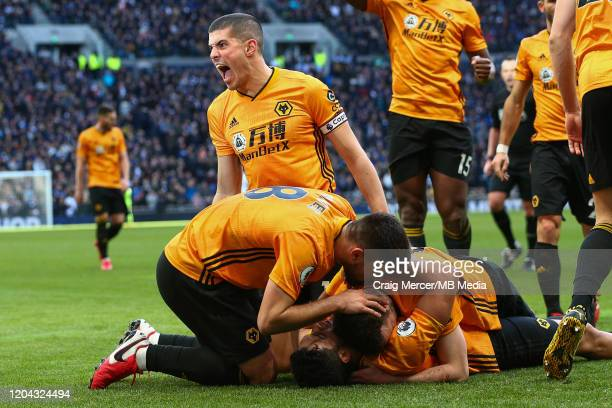 Raul Jimenez of Wolverhampton Wanderers celebrates with team mates after scoring his side's third goal during the Premier League match between...