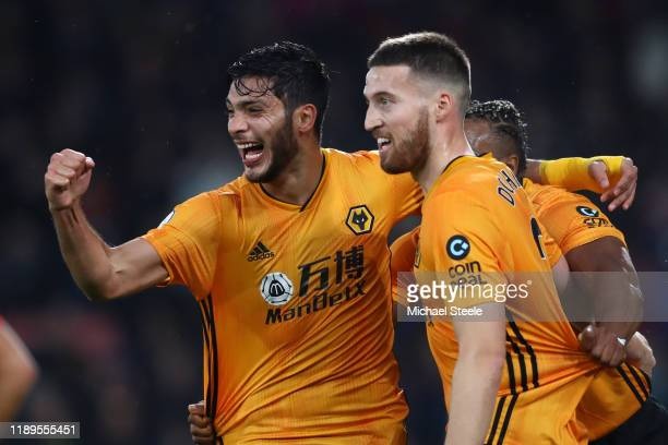 Raul Jimenez of Wolverhampton Wanderers celebrates with teammate Matt Doherty after scoring his team's second goal during the Premier League match...