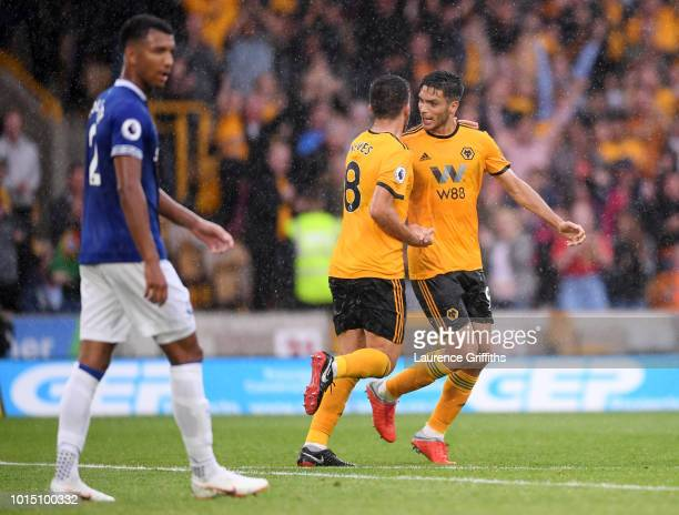 Raul Jimenez of Wolverhampton Wanderers celebrates with teammate Ruben Neves after scoring his team's second goal during the Premier League match...