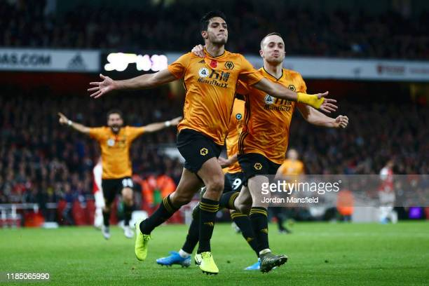 Raul Jimenez of Wolverhampton Wanderers celebrates with teammate Diogo Jota after scoring his team's first goal during the Premier League match...