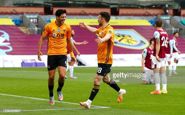 Raul Jimenez of Wolverhampton Wanderers celebrates with teammate Diogo Jota after scoring his sides first goal during the Premier League match...