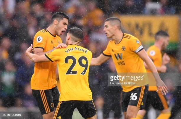 Raul Jimenez of Wolverhampton Wanderers celebrates with teammates Ruben Vinagre and Conor Coady after scoring his team's second goal during the...