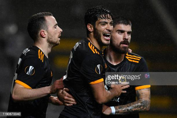 Raul Jimenez of Wolverhampton Wanderers celebrates with teammates Diogo Jota and Ruben Neves of Wolverhampton Wanderers after scoring his team's...