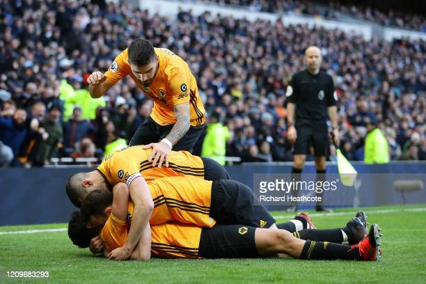 Raul Jimenez of Wolverhampton Wanderers celebrates with teammates after scoring his team's third goal during the Premier League match between...