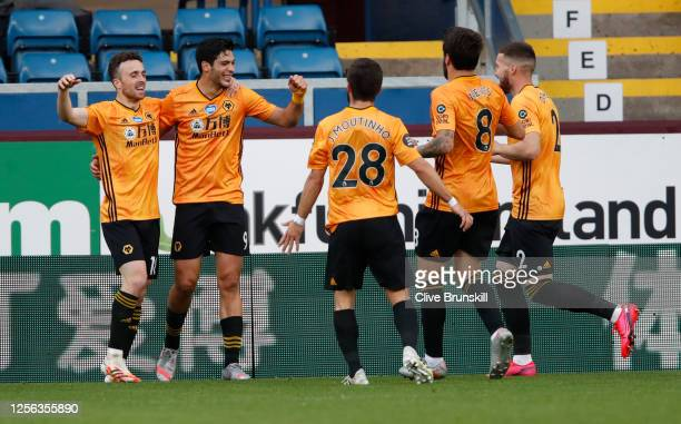 Raul Jimenez of Wolverhampton Wanderers celebrates with teammates after scoring his sides first goal during the Premier League match between Burnley...