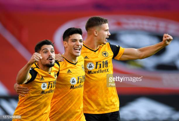 Raul Jimenez of Wolverhampton Wanderers celebrates with teammates after scoring his sides first goal during the Premier League match between...