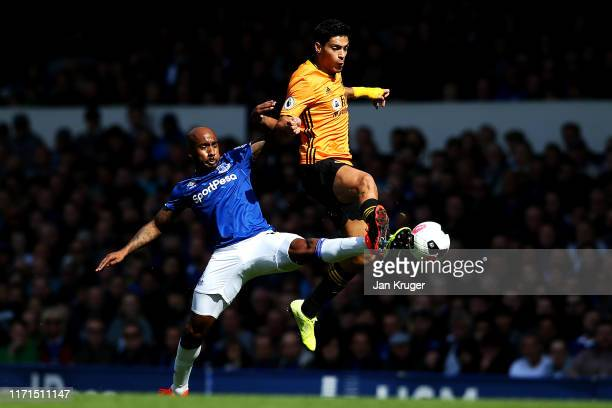 Raul Jimenez of Wolverhampton Wanderers challenges for the ball with Fabian Delph of Everton during the Premier League match between Everton FC and...