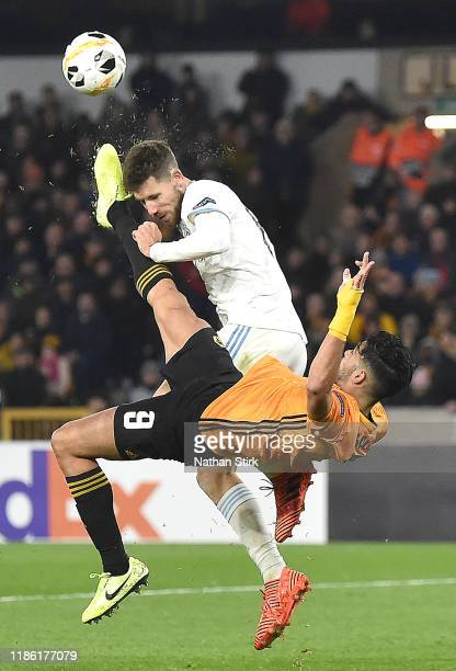 Raul Jimenez of Wolverhampton Wanderers clashes with Kenan Bajric of Slovan Bratislava leading to an injury during the UEFA Europa League group K...