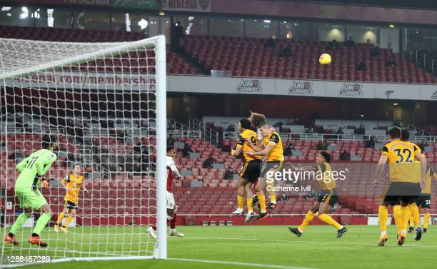Raul Jimenez of Wolverhampton Wanderers collides with David Luiz of Arsenal in the box during the Premier League match between Arsenal and...