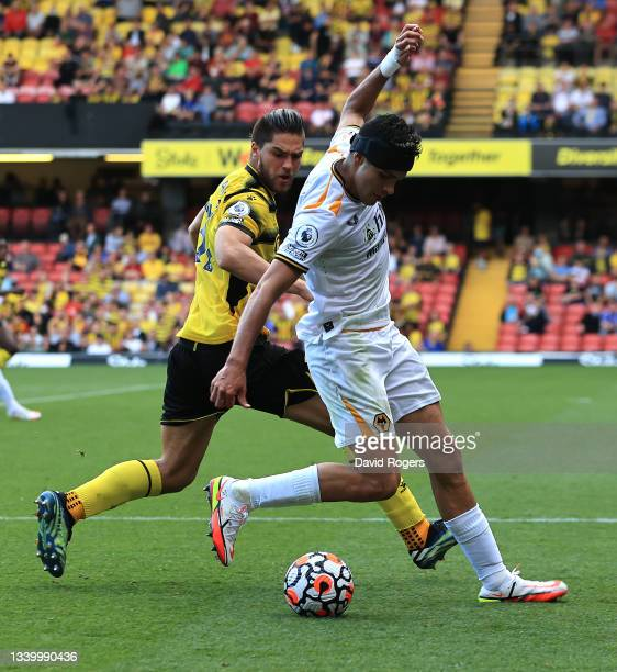Raul Jimenez of Wolverhampton Wanderers controls the ball watched by Francisco Sierralta during the Premier League match between Watford and...