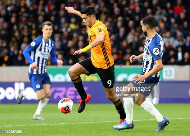 Raul Jimenez of Wolverhampton Wanderers gets past Martin Montoya of Brighton and Hove Albion during the Premier League match between Wolverhampton...