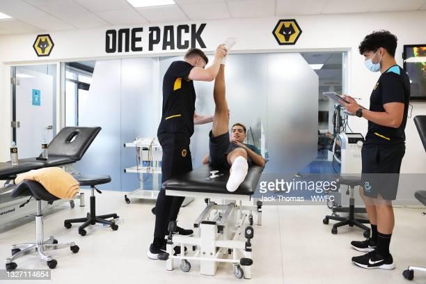 Raul Jimenez of Wolverhampton Wanderers has his measurements taken by Ollie Leaper, Physio of Wolverhampton Wanderers and Carlos Sales at Sir Jack...