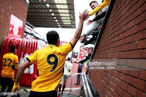 Raul Jimenez of Wolverhampton Wanderers high fives fans as he walks out following half time during the Pre-Season Friendly between Stoke City and...