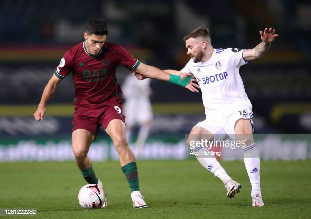 Raul Jimenez of Wolverhampton Wanderers holds off Stuart Dallas of Leeds United during the Premier League match between Leeds United and...