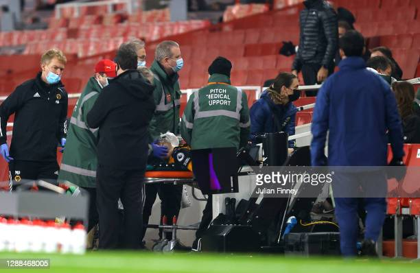 Raul Jimenez of Wolverhampton Wanderers is stretchered off after colliding with David Luiz of Arsenal during the Premier League match between Arsenal...