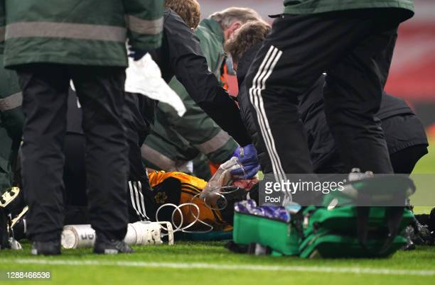 Raul Jimenez of Wolverhampton Wanderers receives medical treatment after a clash with David Luiz of Arsenal during the Premier League match between...