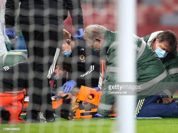 Raul Jimenez of Wolverhampton Wanderers receives medical treatment during the Premier League match between Arsenal and Wolverhampton Wanderers at...