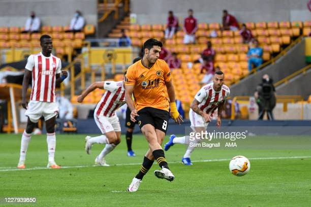 Raul Jimenez of Wolverhampton Wanderers scores a goal to make it 1-0 during the UEFA Europa League round of 16 second leg match between Wolverhampton...
