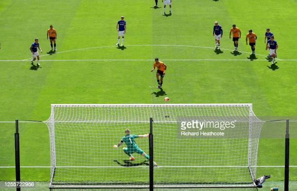 Raul Jimenez of Wolverhampton Wanderers scores his sides first goal from the penalty spot past Jordan Pickford of Everton during during the Premier...