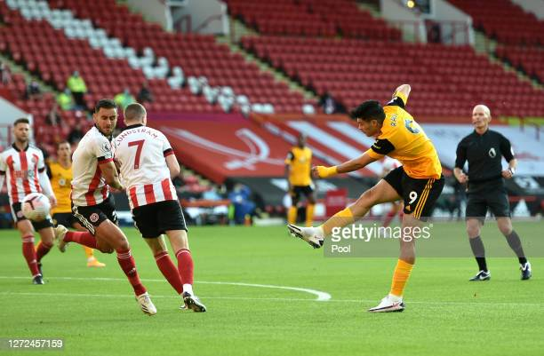 Raul Jimenez of Wolverhampton Wanderers scores his sides first goal during the Premier League match between Sheffield United and Wolverhampton...